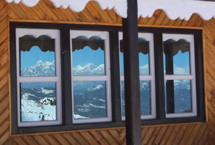 Mt. Everest view through lodge window -  himaland.com
